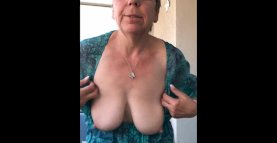 Horny granny shows tits and ass